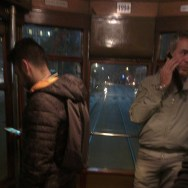 People who ride the trams     by southcoasting milan, nightshots, nighttime, passengers,