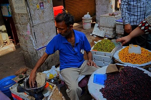 Vendors on the streets of Delhi - Seasonal fruit seller