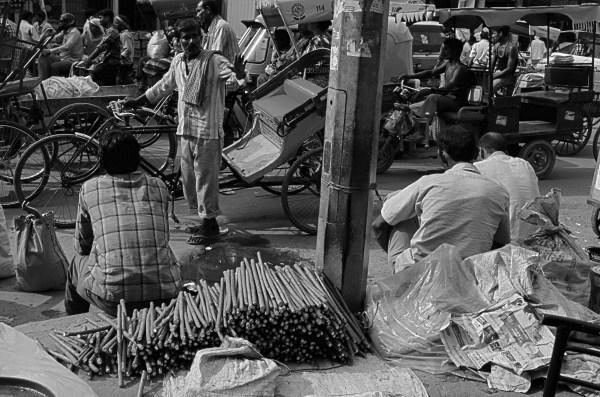 Vendors on the streets of Delhi - the Datun-seller... neem or kikar sticks used as a tooth-brush