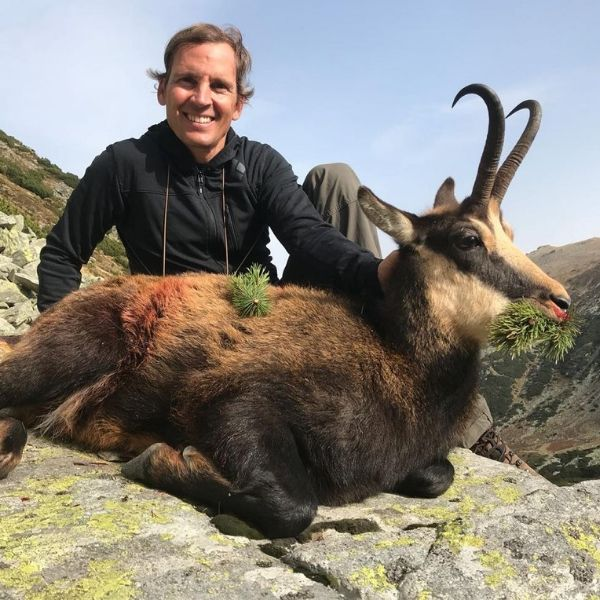 hunter with ibex trophy in the alps