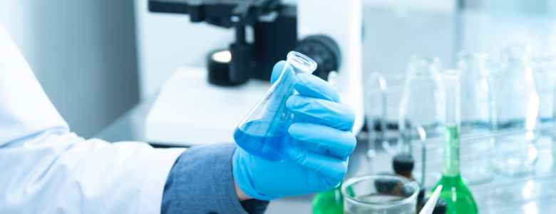 person holding laboratory flask