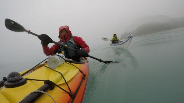 close-up of paddling navigating foggy weather