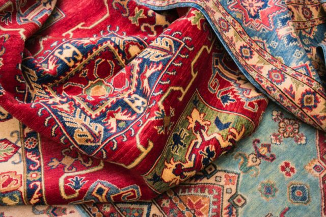 Colorful textiles with intricate patterns.