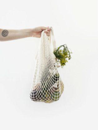 White mesh produce bag full of vegetables