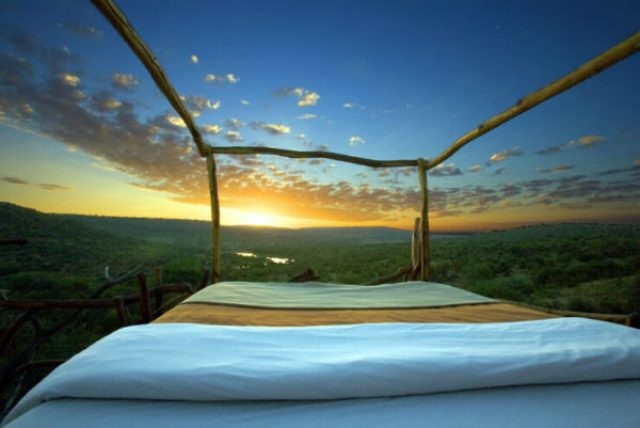 Sunset over the horizon from an outdoor Starbed at Loisaba Conservancy