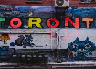 A graffiti mural of cartoon characters below the word 'Toronto' in different colors.
