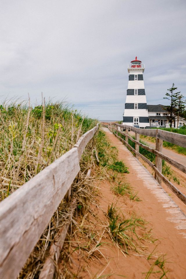 a white-and-black striped lighthouse.