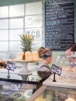 Cabinet and menu board in light filled cafe, Melbourne