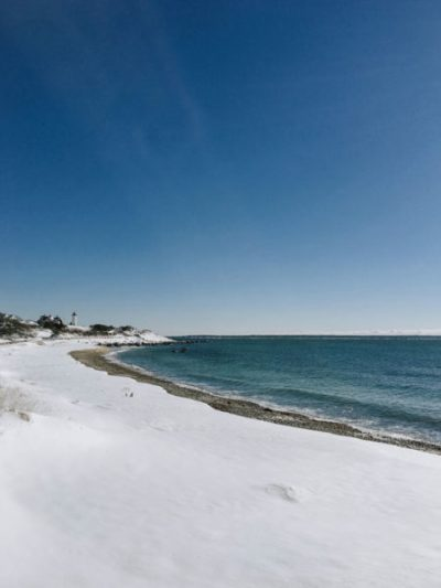 A beach covered in snow on Cape Cod