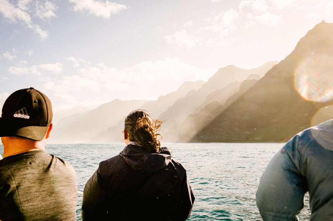 travelers look out on the water