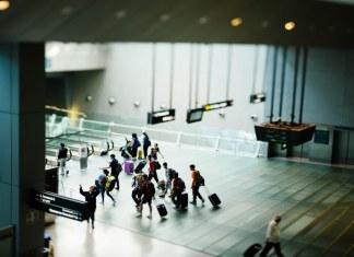 people walk inside an airport