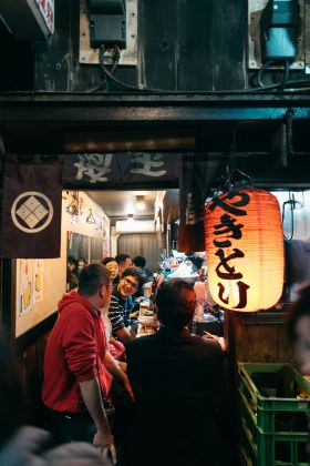 people at bar with japanese characters