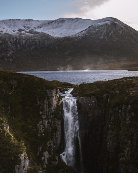 waterfall flowing from mountain lake