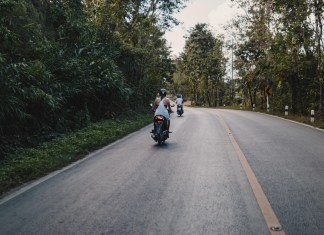 scooters on a mountain road