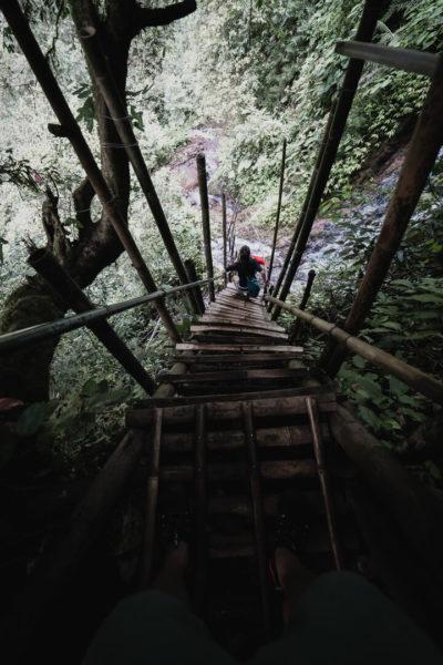 descending rope bridge on cliffside