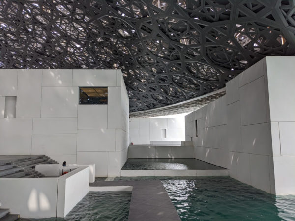 art gallery interior with water pools