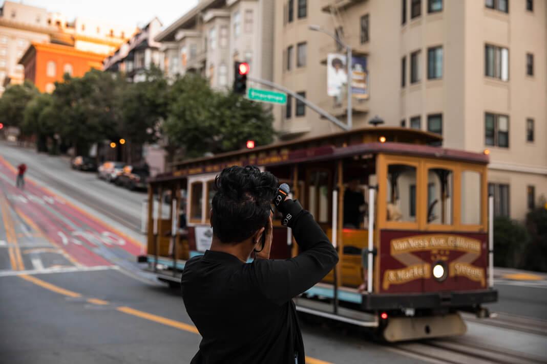 black photographer looking at streetcar