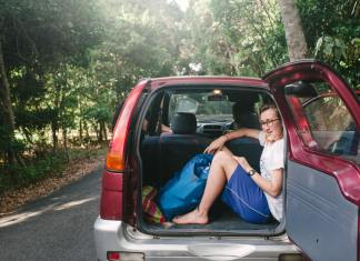 solo traveler hitchhiking in trunk of car