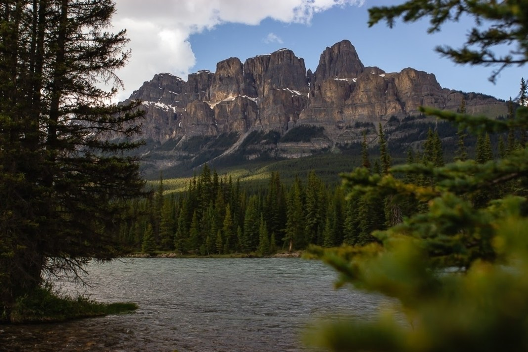 lake in front of Canadian rockies