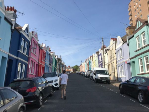uphill view of colorful housefronts