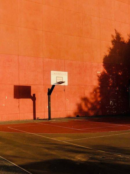 basketball goal against orange wall