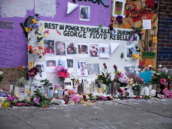 protest memorial covered in flowers