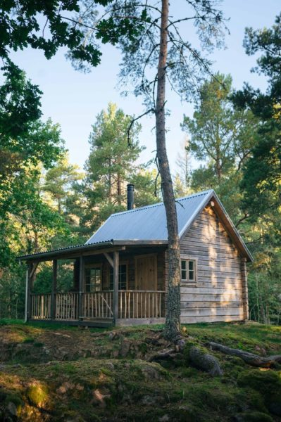 wooden cabin with porch