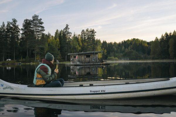 kayaker looking toward cabin