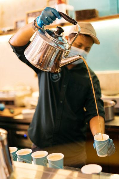 man pouring arabic coffee