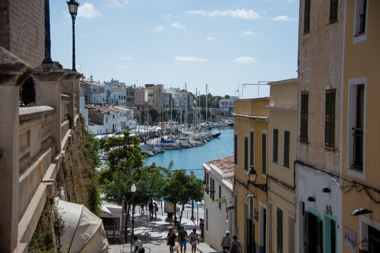 Old shuttered buildings and harbour in Menorca, Balearic Islands