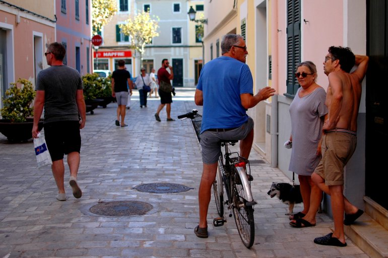 Locals chat in street in Menorca's Ciutadella
