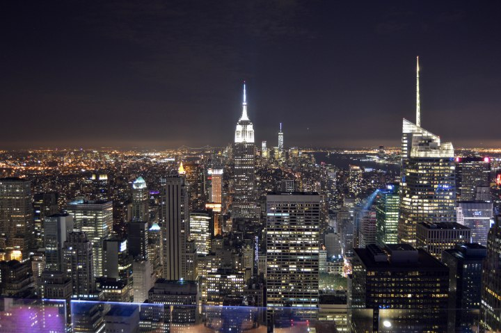 17 Easy Ways to Save Money on Travel - New York City Skyline at Night - View from Rockefeller Centre