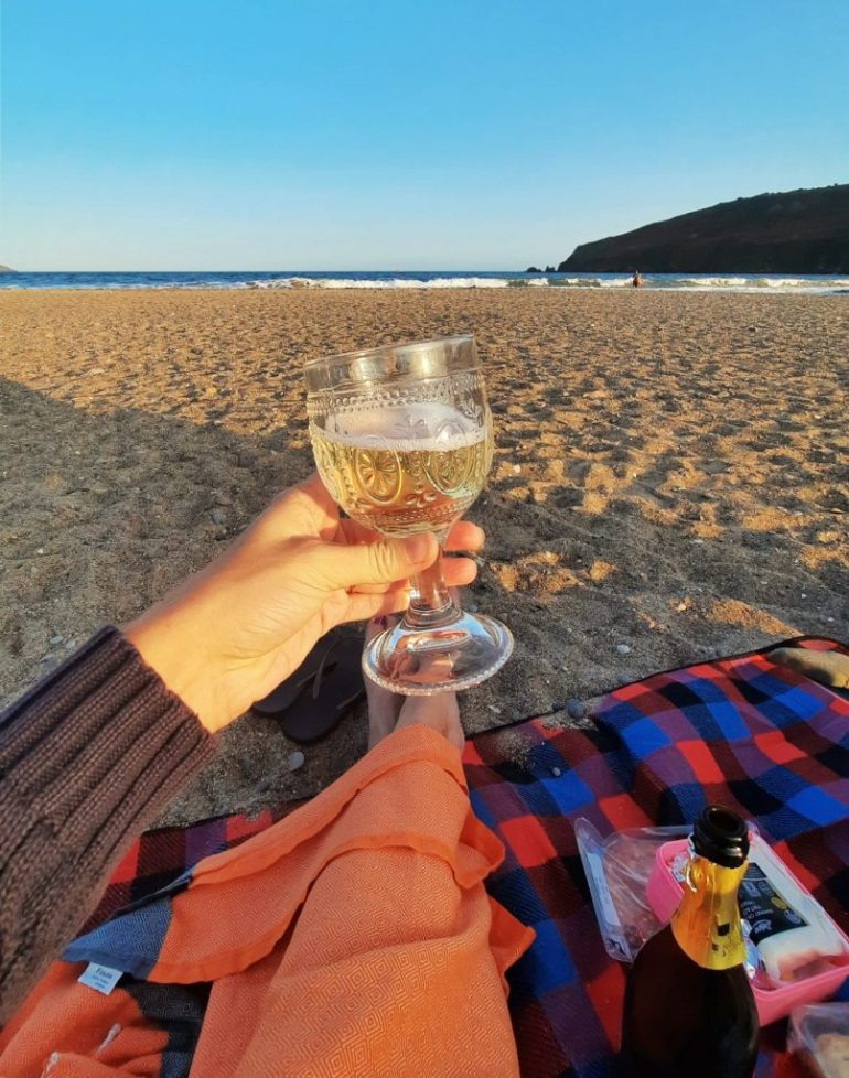 Drinking prosecco on Freshwater East Beach in Pembrokeshire, South Wales
