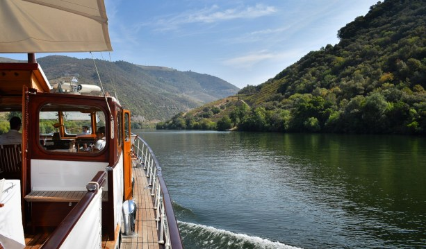 Riverboat cruising down the Douro River