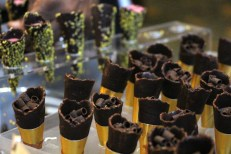 Valrhona caramella chocolate ganache cones and pistachio strawberry cones.
