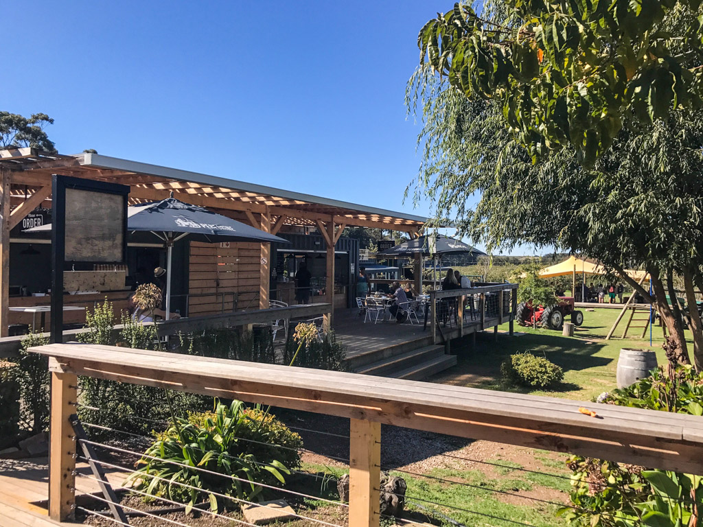 The outdoor seating and play area at Peregrine Farm Stall