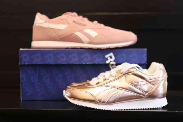 Classic Reebok sneakers in rose gold at DSW