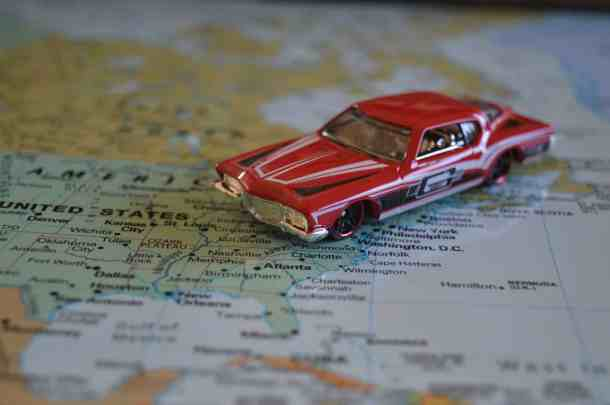 A toy car on a map of the united states