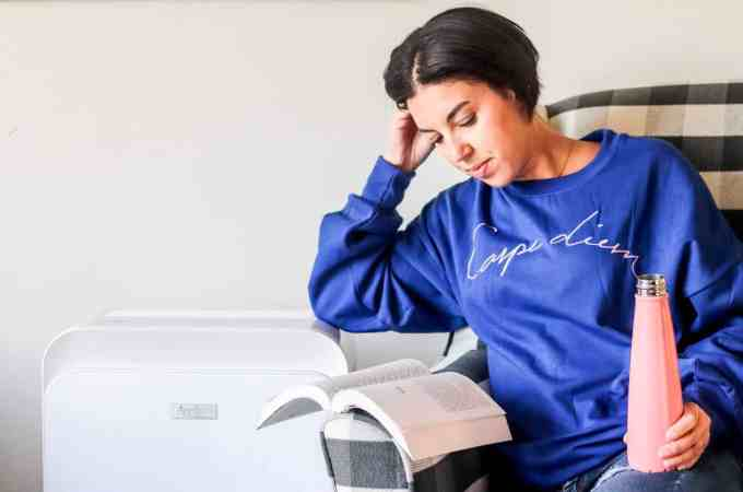 Woman reading and Aprilaire air purifier