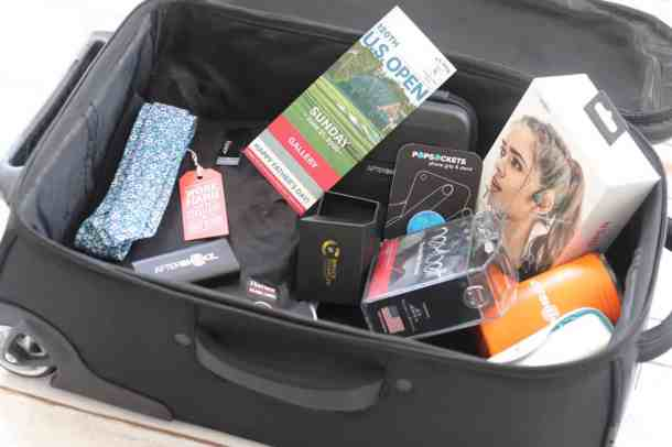 Suitcase full of travel gifts for men