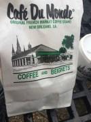 cafe du monde bag park bench