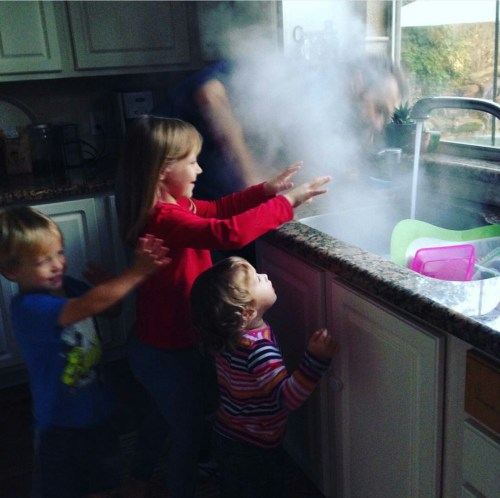 Molly's husband gets the kids involved in the kitchen