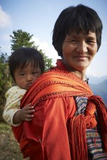 Bhutan: Grandmother with her granddaughter.