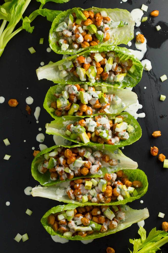 Buffalo Chickpea Lettuce Wraps | Roasted chickpeas are tossed with a spicy buffalo sauce and layered into a lettuce wrap, then topped with crunch celery and creamy avocado! Drizzle with vegan ranch dressing for the perfect lunch or light dinner! | https://passtheplants.com