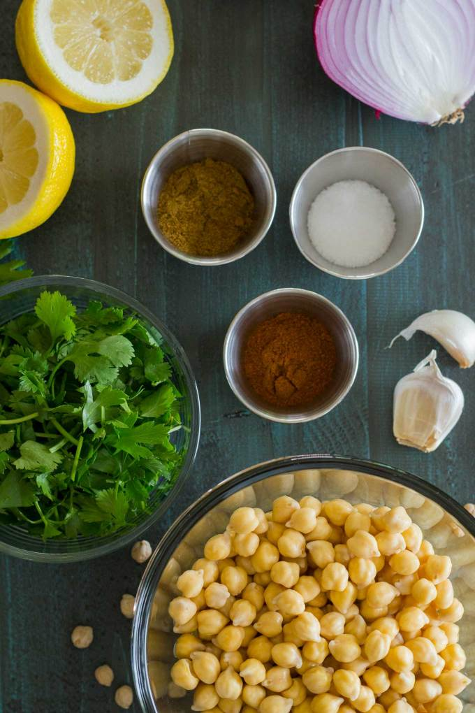 Oven-Baked Falafel ingredients are soaked chickpeas, lemon, parsley, ground cumin, cayenne powder, salt, fresh lemon, and red onion | Plant-based | Oil-free | Vegan | Gluten-free | https://passtheplants.com/