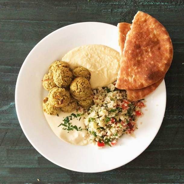 Oven-Baked Falafel in mezze platter with hummus, tahini sauce, quinoa tabouli salad, and pita bread   Plant-based   Oil-free   Vegan   Gluten-free   https://passtheplants.com/