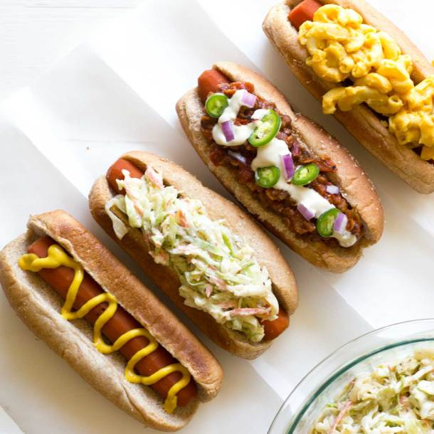 Close up of carrot dogs with various toppings | Easy Carrot Dogs | Plant-based | Vegan | Recipe | https://passtheplants.com/