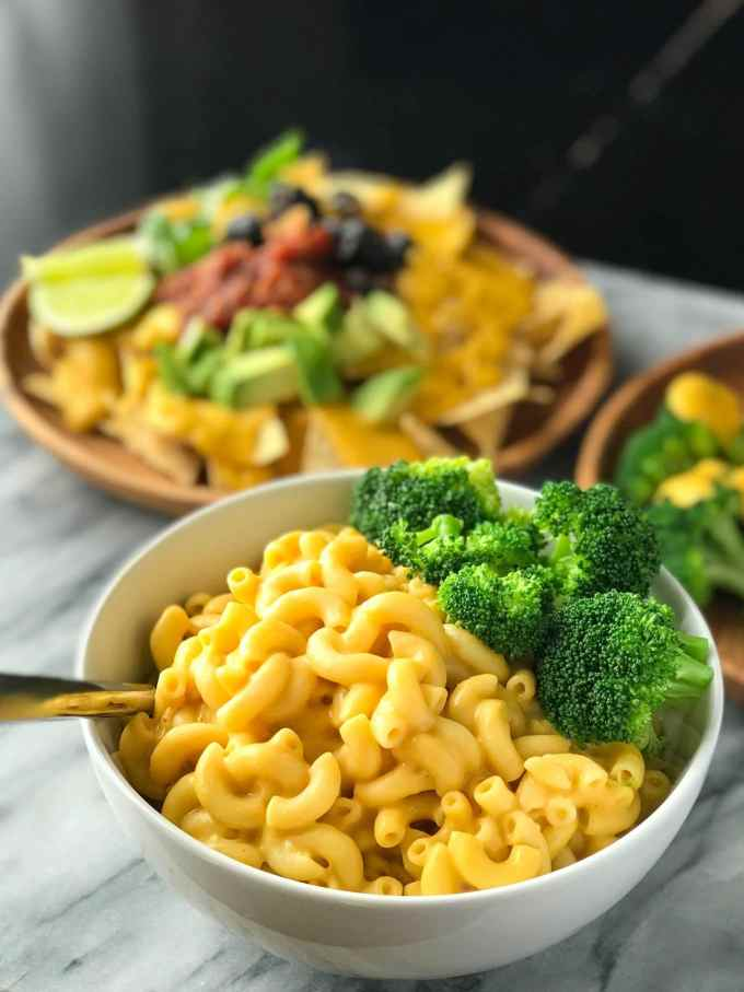 Protein-Packed Vegan Cheese Sauce   Bowl of vegan macaroni and cheese   Whole foods plant based   Oil-free   #plantbased #vegan #oilfree #wfbp   https://passtheplants.com/