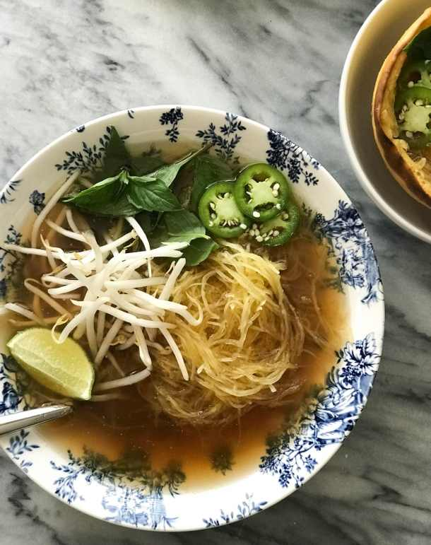 Spaghetti Squash Vegan Pho   Soup in large bowl topped with mung beans sprouts, lime, thai basil, jalapeño   https://passtheplants.com/