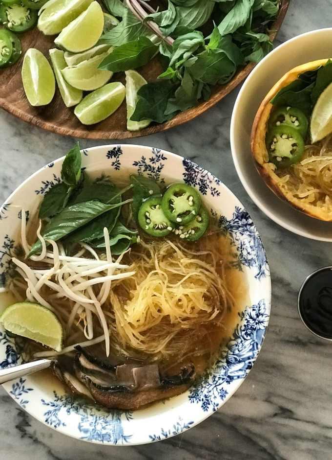 Spaghetti Squash Vegan Pho | Soup in bowl with roasted portobello mushrooms and toppings | https://passtheplants.com/